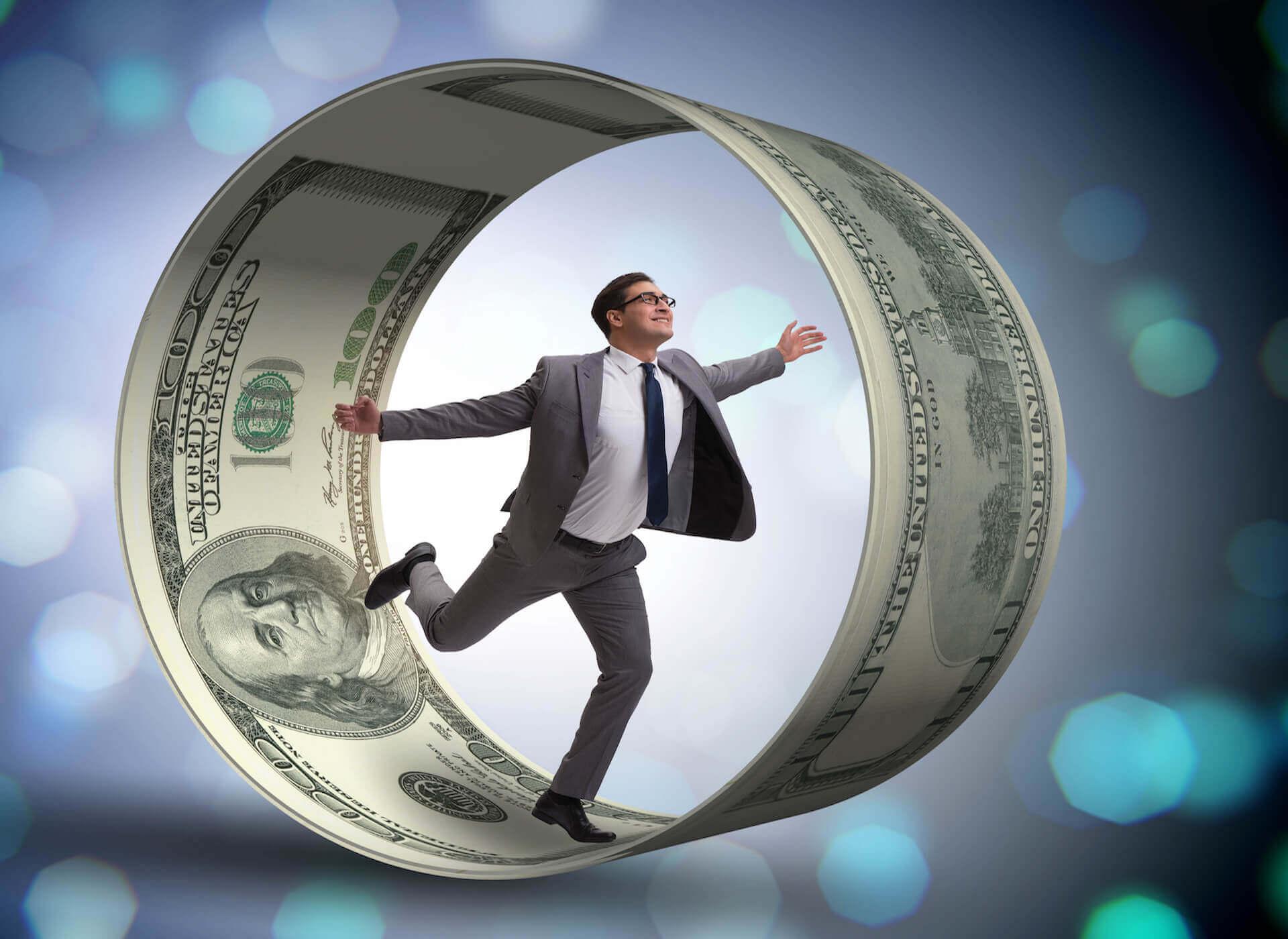 Guy in hamster wheel made of money