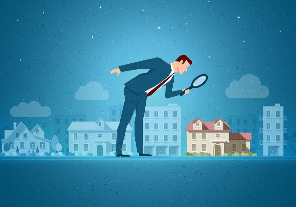 Magnifying glass over real estate assets- smaller